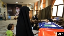 An Iranian woman casts her vote at a polling station in Tehran.