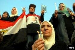 ИМ басын алды деген 21 христианның рухына арнап шіркеуде шырақ жағу шарасы. Египет, Каир, 17 ақпан 2015 жыл.