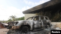A burned car is seen in front of the U.S. Consulate in Benghazi, Libya, after it was attacked and set on fire by gunmen on September 11, 2012.