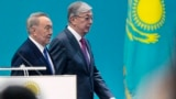Kazakhstan Election-Kazakhstan's interim President Kassym-Jomart Tokayev, left, and former Kazakh President Nursultan Nazarbayev, walk together during the Nur Otan party congress in Nur-Sultan, the capital city of Kazakhstan, Tuesday, April 23, 2019. Kaza