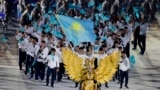 Indonesia Asian Games Opening Ceremony-Kazakhstan's team march into the Gelora Bung Karno Stadium during the opening ceremony for the 18th Asian Games , Jakarta, Indonesia, Saturday, Aug. 18, 2018. (AP Photo/Aaron Favila)