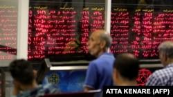 IRAN -- Iranian men monitor the stock market at Tehran Stock Exchange on July 1, 2019.