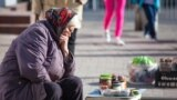 A woman sells homemade canned food on the street in Kaliningrad.