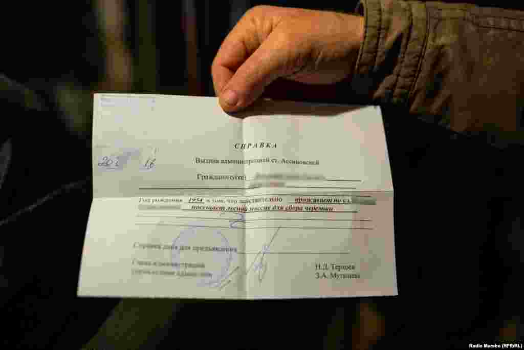 Chechens pay 100 rubles for a permit to pick wild garlic. Many complain, but admit the paper offers some security from being'mistaken' for fighters.