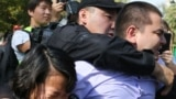 Kazakh law enforcement officers detain participants at an opposition rally in Almaty on September 21.