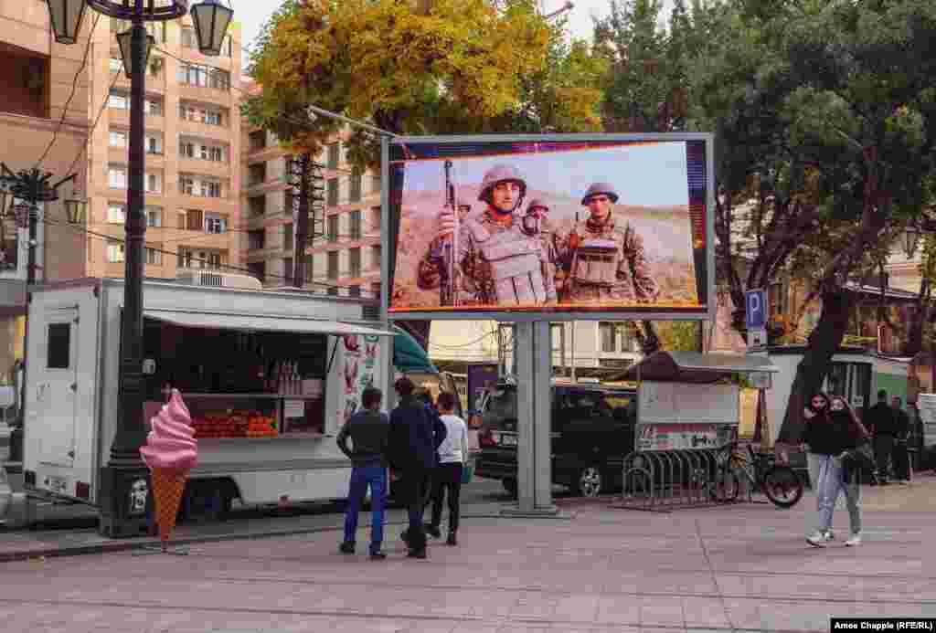 A television plays a loop of soldiers and military exercises in downtown Yerevan on October 28.