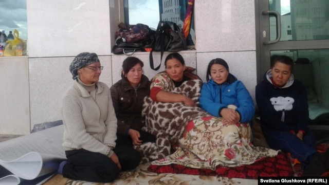 Women whose families face eviction from their houses hold a protest action in front of the government office in Astana on July 27.
