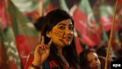 A Pakistani opposition supporter listens to a speech by Imran Khan on the seventh day of a mass antigovernment protest in Islamabad on August 21.