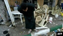 Upturned tables and chairs outside a restaurant following twin blasts in the southern Iraqi city of Karbala on November 25.