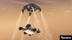 """""""Curiosity"""" robotynyň Marsa gonuşyny görkezýän bir şekil."""
