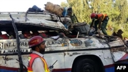 FILE: The aftermath of an accident in Pakistan.