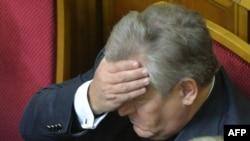 Специальный посланник Евросоюза в Украине Александр Квасьневский после голосования в Верховной Раде. Киев, 21 ноября 2013 года.