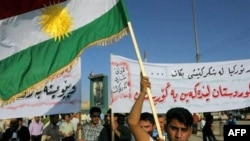 Kurds wave their flag during a demonstration against Turkey in Kirkuk.