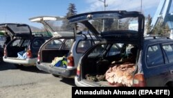 FILE: Cars are loaded with the bodies of civilians allegedly killed in a military operation by international forces in Zurmat district of Paktia province in December 2018.