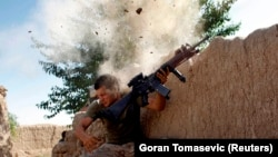 FILE: A U.S. Marine dodging insurgents bullets in Helmand (May 2008).
