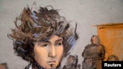 Джохар Царнаев во время появления на досудебных слушаниях 18 декабря 2014 года