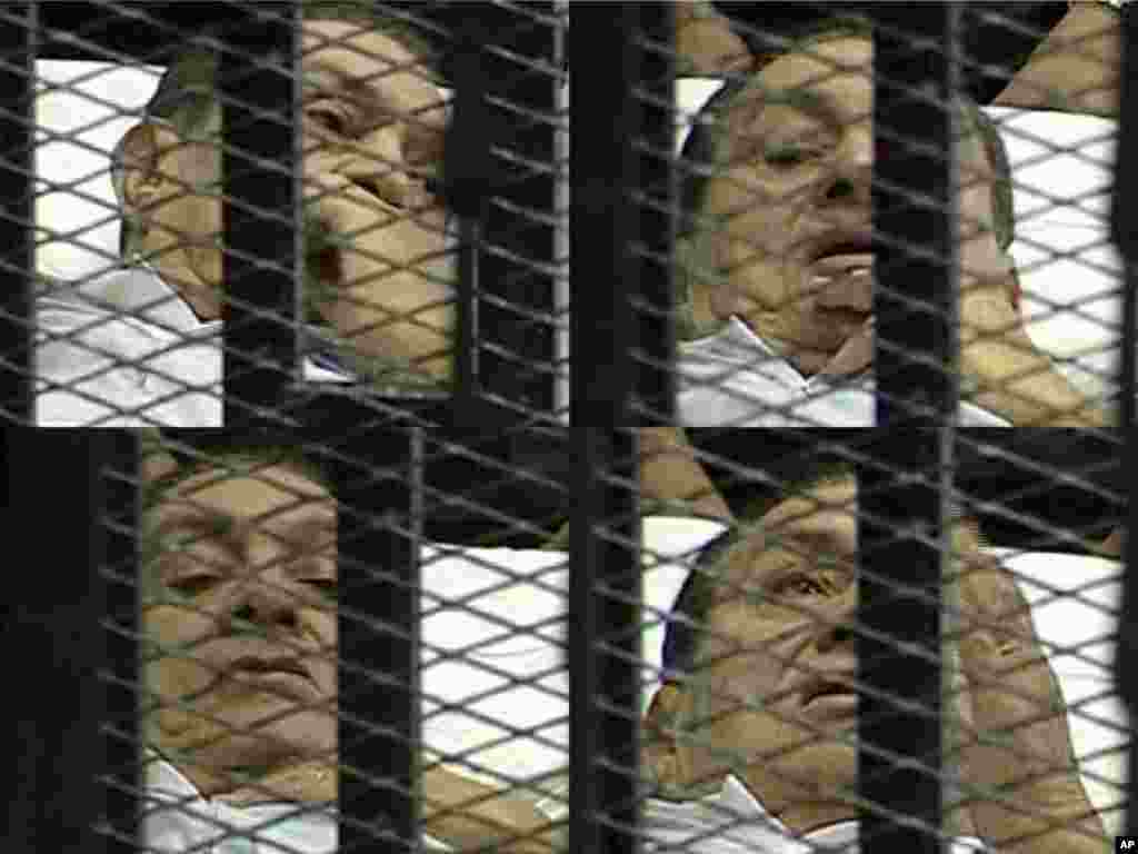 This combination image made from video taken from Egyptian State Television shows 83-year-old Hosni Mubarak on a hospital bed inside a cage of mesh and iron bars in a Cairo courtroom as his historic trial began on charges of corruption and ordering the killing of protesters during the uprising that ousted him. It was Egyptians' first look at their former president since February 10, the day before his fall, when he gave a defiant speech refusing to resign.