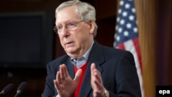 U.S. Senate Republican leader Mitch McConnell talks to reporters on December 12.