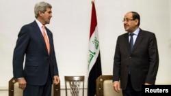 رئيس الوزراء نوري المالكي ووزير الخارجية جون كيري في بغداد - 23 حزيران 2014