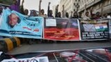 Angry Islamists chant slogans at a demonstration against the independent Pakistani newspaper Dawn outside the Press Club in Karachi on December 3.