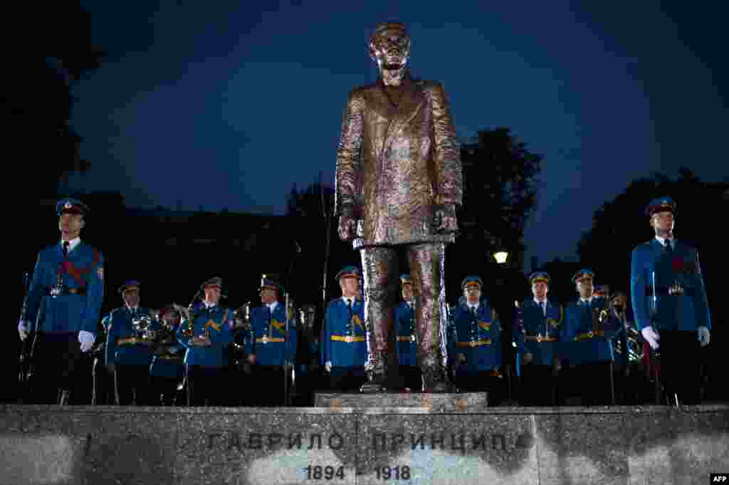 A Serbian Army honor guard stands behind a bronze statue of Gavrilo Princip after an unveiling ceremony at a park in downtown Belgrade on June 28. The Bosnian Serb nationalist, whose assassination of Archduke Franz Ferdinand 101 years ago sparked World War I, is seen as an icon of Serb patriotism. (AFP/Andrej Isakovic)