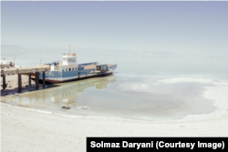 A photo by Solmaz Daryani shot in 2014 shows a ferry left stranded by the receding water of Lake Urmia.