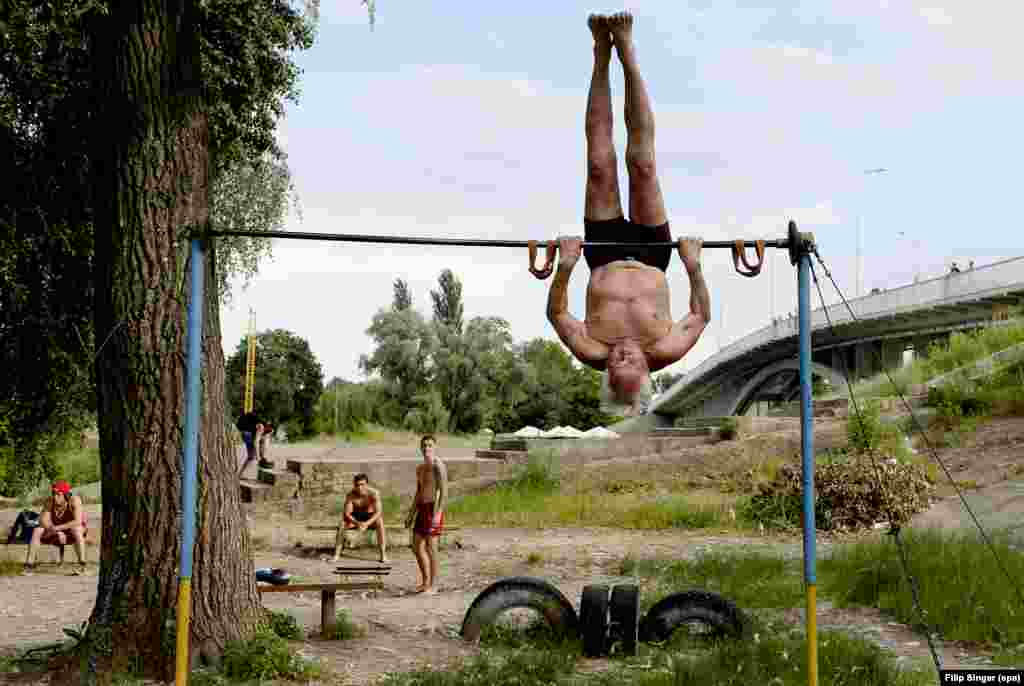 An 83-year-old showing the youngsters how it's done. The gym began with a single chin-up bar in the the late 1960s.