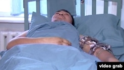 An injured border guard lies in hospital following a shootout between Kyrgyz and Tajik forces that left eight people injured.