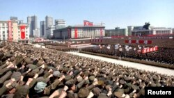 North Koreans attend a rally in support of leader Kim Jong Un's order to put its missile units on standby in preparation for a possible war against the United States and South Korea in Pyongyang on March 29.