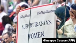 "A banner reading ""Support Iranian women to attend stadiums"" is displayed during the Russia 2018 World Cup in Saint Petersburg, June 15, 2018"