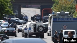 Armenia - Police vehicles block a road leading a police station in Yerevan seized by radical opposition activists, 17Jul2016.