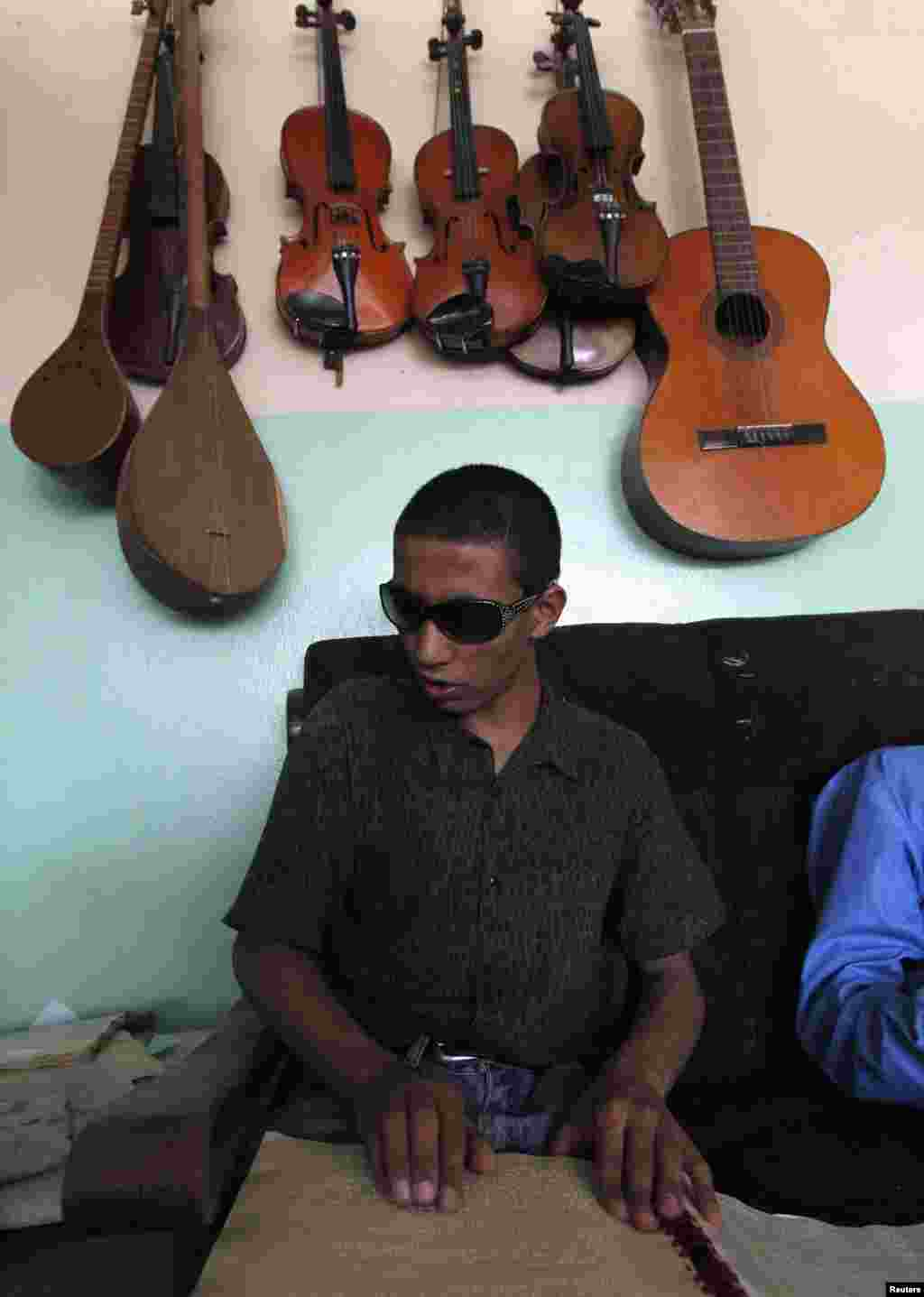 A blind student reads Braille during a music lesson at the Kabul Blind School.