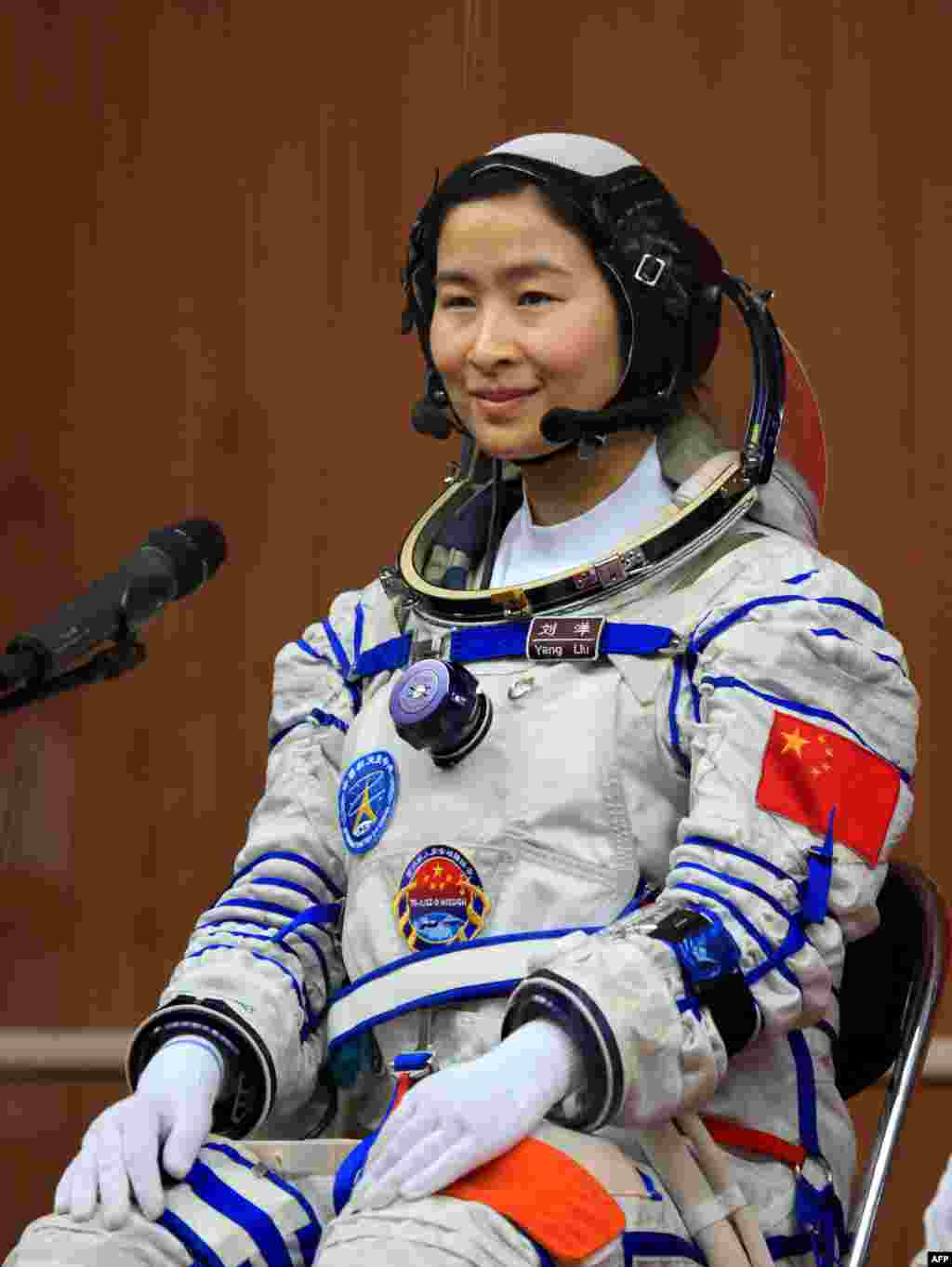 Liu Yang in her spacesuit posing for an official photo at the Jiuquan space base on June 12.