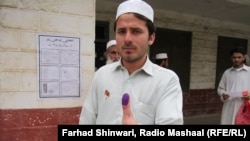 A voter shows his inked thumb in the Khyber tribal district after casting his ballot.