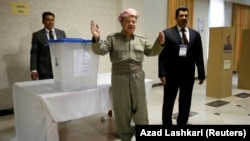 Iraqi Kurdish President Masud Barzani casts his vote during the Kurdish independence referendum in Irbil on September 25.