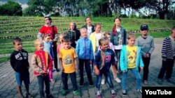 "Belarus - Children are singing a famous song by Lyavon Volski ""Three turtles"". Minsk, 2016"