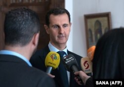 Syrian President Bashar al-Assad has been supported by Russia and Iran in his war-torn country. (file photo)