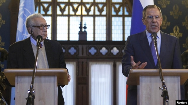 Russian Foreign Minister Sergei Lavrov (right) and UN -Arab League peace mediator Lakhdar Brahimi speak at a joint news conference in Moscow on December 29.