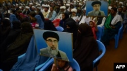 FILE: Supporters of Gulbuddin Hekmatyar, the leader of Hizb-i-Islami, attend a meeting in Herat.