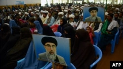 FILE: Supporters of Gulbuddin Hekmatyar, the leader of Hizb-i-Islami, attend a meeting in the western Afghan city of Herat.