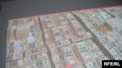 Пачки долларов из якобы «черной кассы» Мухтара Джакишева. Видеосъемка КНБ. Астана, 1 июня 2009 года.