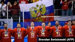 Olympic Athletes from Russia sing the Russia national anthem after receiving their gold medals in men's ice hockey on February 25.