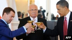 U.S. President Barack Obama (right) toasts with Czech counterpart Vaclav Klaus and Russian President Dmitry Medvedev (right) after signing the New START accord in Prague in 2010.