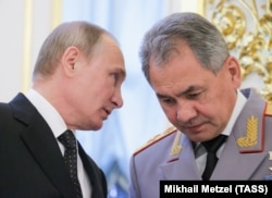 Russian President Vladimir Putin (left) and Defense Minister Sergei Shoigu (file photo)