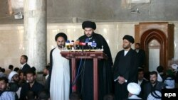 Muqtada al-Sadr speaks during Friday Prayers at the Al-Kufah Mosque in Al-Najaf in 2006.