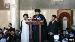 Muqtada al-Sadr speaks during Friday Prayers at the Al-Kufah Mosque in Al-Najaf in 2006.