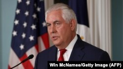 U.S. Secretary of State Rex Tillerson answers questions after delivering a statement at the State Department in Washington on October 4.