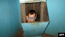 This Russian man had to be rescued from a trash chute after trying to escape his girlfriend.