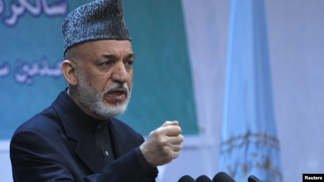 Afghan President Hamid Karzai speaks during a gathering in Kabul on April 17.