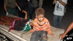Victims arrive at a hospital in Multan on September 13.